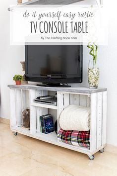 This Rustic TV Console Table is so easy to make. With a couple crates, a few boards, and regular tools you can create a super fun table for your TV. You can paint it in any combination and technique you love and make a unique piece of furniture that will make your room gorgeous!