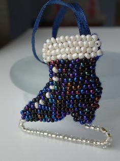 """Ice Skate - hand-beaded Victorian-style booted ice- skate hanging ornament by DewCatDesigns.  This beautiful decoration features petrol blue/black seed beads with a pearlescent white seed-bead """"cuff"""" and laces. From $13"""