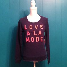 """NWT VS sweatshirt """"LOVE A LA MODE"""" sweatshirt from Victoria Secret. Brand new with tags. Navy blue sweatshirts with coral letters. No trades, price firm Victoria's Secret Tops Sweatshirts & Hoodies"""