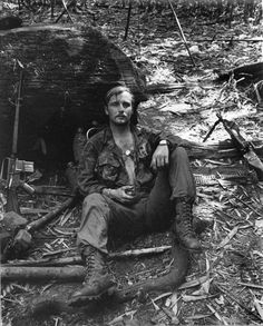 A US Army soldier takes a well deserved break while humping the boonies - Vietnam