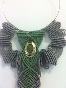 A unique Macrame necklace with grey cord(4mm) . I hand painted it with spring green color.There is a gold-green vintage button in the middle.