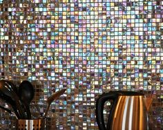 The basement's kitchen is one of Peter Silverstone's favourite places in the house. A rainbow of light cascades over the room from the glass-tile backsplash.