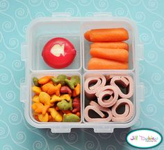 meet the dubiens bllog    Here's another bento for her afternoon nutrition break. She had a babybel cheese with a cute little fish shape cut out of the wax, a container of goldfish crackers, a container of turkey bologna roll-ups, and a container of baby carrots.
