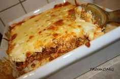 Pastitsio or Greek lasagne. Your kids will love this! - Bek Print this recipe * 500g mince * 1 onion peeled and quartered * 1 clove garlic * 10g olive oil * 400g tinned or fresh tomatoes * 50g tomato paste * 150g beef stock * Salt and ground black pepper * 1 tsp dried oregano * 1 tsp brown sugar * 1 portion EDC béchamel sauce with cheese * 100g crumbled feta cheese * 250g cheddar cheese (150g for béchamel sauce) * Cooked pasta of ...