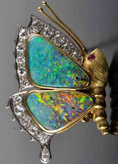 Opal diamond butterfly brooch  18k yellow gold, opal ( approximately 7.00cts), diamond (16 = approx. 1.50cts) butterfly brooch 1.78 inches x 1.12 inches, 16.8 grams