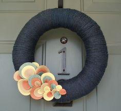 Yarn wreath with felt embelishments