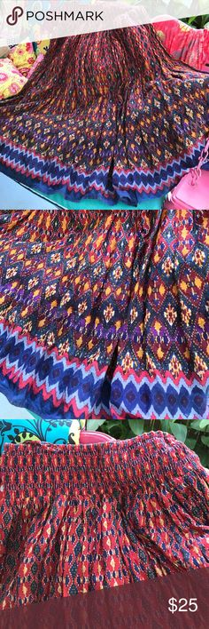 Gorgeous stretchy tube top dress or skirt This is so versatile because it's a tube dress, or can be brought down from the bust to make a comfortable waist, and a midi skirt! Magnificent Fall colors, with lots of fabric. Lovely red liner. New condition worn twice. Very eye catching, tribal design! Cato Skirts Maxi