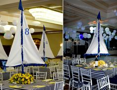 Custom designed centerpiece with table number on the sail set on a bed of yellow roses.