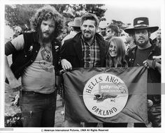 Sonny Barger and the Hell's Angels holding their flag in a scene from the film 'Hell's Angels '69', 1969.
