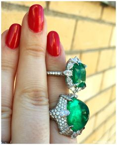 Two emerald and diamond rings by VALANI; the Denali ring, with a 10.57 carat sugarloaf cabochon emerald, and the Flores ring with a 7.43 carat cushion cut emerald.