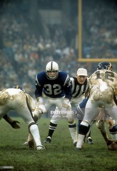 This sort of looks like Dan Curtis (Duke Univ) playing for Baltimore Colts against I'm not sure who.  CC