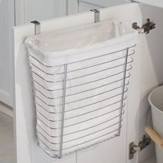 Get an over-the-cabinet-door wastebasket. | 44 Brilliant Space-Saving Storage Solutions For Your RV/Camper