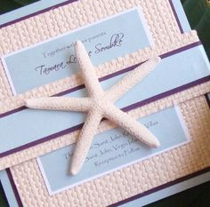 "This Starfish Invitation exudes the elegance of a true beach chic wedding. They are one of a kind and can be embellished with a 3-layer hand woven belly band and adorned with either a real starfish or sandollar embellishment. Details – Size: 7"" Square 4-Layer Invite, layered with Metallic Cardstock, followed by bamboo weaved paper, another layer of accent metallic card stock and then completed with your custom"