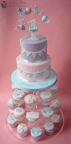 First Birthday Cupcake Tower - Pretty pastel cupcakes for a little girl's first birthday.