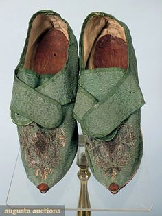 "Lady's shoes, c1720, French; Dark green figured silk, cross over latchets and silver metallic embroidered and sequin decorated vamps, low white leather heels and rands, homespun linen lining, Wd 2.25"", L 9.25"""