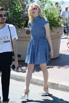Elle Fanning frolics about in the sea at Cannes Film Festival #dailymail
