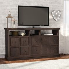 Transform your living room from dated and dull to vibrant and stylish with most popular audio video furniture. The right TV stand can transform a drab room into a delightful space. This dark walnut color TV stand is the perfect complement to your decor. Featuring wood cabinet doors on both sides and front open shelving this piece is perfect for storing all of your media components.