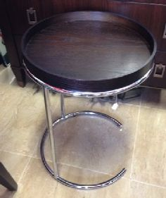 "West Elm's version of a Mid-Century Modern side table. Bright chrome with round, dark wood tray top. Like-New condition, priced well under West Elm retail. 18"" diameter, 24.75"" tall. SOLD"