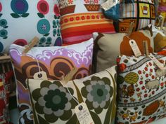 Vintage fabric cushions at Vintage Village Stockport.  *Note* tags held on by clothes pins! Smart and retro