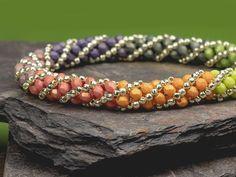 Free pattern at Rainbow Ombre Russian Spiral Stitch bracelet featuring Czech glass fire-polished beads. Free pattern at Seed Bead Bracelets Diy, Beaded Bracelets Tutorial, Beaded Bracelet Patterns, Silver Bracelets, Bead Patterns, Seed Bead Bracelets Tutorials, Free Beading Tutorials, Embroidery Bracelets, Bracelets