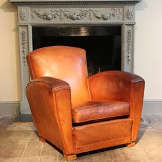 Leather Armchairs & Leather Sofas - A good quality and with exceptional colour, 1930s/40s French single club chair , retaining the original tan leather, that will work well in most settings.