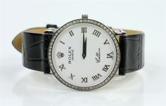 "Gentleman's Rolex Cellini wrist watch, with original Rolex leather band, stainless steel back, numbered 88065, 1 1/8"" dia (face), 9"" l."