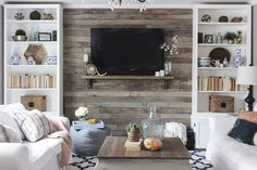 Wood Pallets Wood pallet accent wall between two bookshelves - How to build a pallet accent wall in an afternoon. Includes tips on safe pallets to use, and building wire pathways for mounting a TV. Pallet Accent Wall, Diy Pallet Wall, Pallet Walls, Accent Walls, Media Room Decor, Living Room Decor, Living Walls, Bachelor Pad Decor, Decor Pad