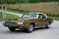 1971 Pontiac GTO convertible - this Aztec Gold, factory A/C car was one of 18 built with the High Output mill, the Muncie & mandatory Saf-T-Track rear. 1966 Chevelle, Chevrolet Camaro, Chevy, Convertible, 1966 Gto, Pontiac Cars, Pontiac Lemans, Gm Car, Barrett Jackson Auction