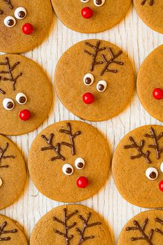 Reindeer Gingerbread Cookies - these are so fun!! My kids loved them! Made with melted white and dark chocolate and a red Sixlet (mini red m&m works too).
