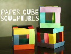 Colorful paper cube sculptures using 12 paper strips for each cube and glue.