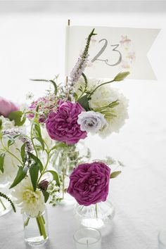 Employ a smattering of bud vases—instead of one huge arrangement—to decorate each guest table.