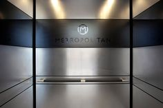 LEVELe-104 Elevator Interior with panels in Stainless Steel with Marquisette finish and Fused Graphite with Mirror finish and custom Eco-Etch pattern; Sextant handrail at Metropolitan Bank Mississippi Headquarters, Ridgeland, Mississippi