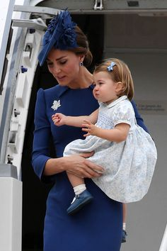 Princess Charlotte pulls some adorable faces as mum Kate holds her up arriving in Canada.