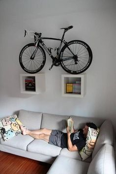 bike storage ideas and modern interior design Here is a collection of space-saving bike storage ideas that give sports enthusiasts great inspirations and help decorate their home interiors in a unique, sport-inspired, and creative style Hanging Bike Rack, Bike Hanger, Wall Bike Rack, Home Bike Rack, Bike Shelf, Hanger Rack, Bicycle Wall Mount, Bike Mount, Bike Storage Apartment