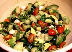 Yum! 2 cucumbers- cut up, 1 pint cherry or grape tomatoes (about 30), 2 tablespoons chopped fresh basil, 1 cup fresh mozzarella (I like to use the little balls), 1 avocado, 1 tablespoon extra virgin olive oil, 2 tablespoons balsamic vinegar, 1 teaspoon garlic powder, Salt and pepper to taste