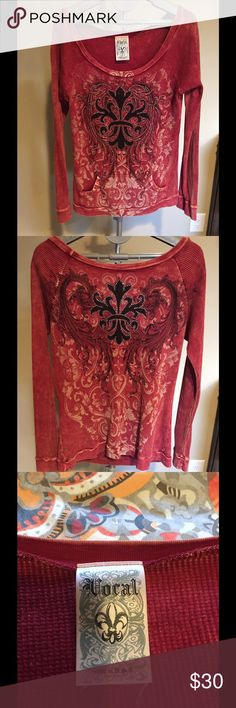 ❤💠♠️Vocal Embellished Long Sleeve Top♠️💠❤ Beautifully embellished Vocal long sleeve shirt. Shirt is red with black & beige printed design with silver rhinestones on front and back. It has two front pockets and is 100% cotton. Has only been worn several times and is in great condition. Tops