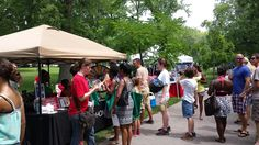 """Look at that line for our """"Spin & Win"""" prize wheel! We'll be at the Festival of Nations in Tower Grove Park all weekend. Stop by and say hi! Buy this Prize Wheel at http://PrizeWheel.com/products/tabletop-prize-wheels/tabletop-black-clicker-prize-wheel-18-slot/."""