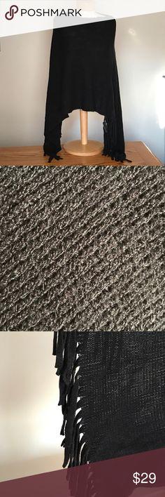 """New Madeline black knit poncho NWT Madeline black knit poncho. 22"""" long in the middle. 38"""" long on the sides (on photo). Acrylic. Madeline Jackets & Coats"""