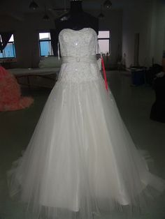 """Milly's Bridal Replica. Inspiration dress pinned with """"Jasmine Couture"""" on it. Lining visible beneath organza. Not so on original."""