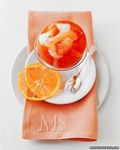 Grapefruit Mimosas - These grapefruit mimosas are brunch salad and cocktail in one. Segments of red and white grapefruit, navel oranges, and blood oranges are arranged in candied grapefruit bowls and topped with Champagne.