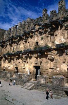 Roman Theatre stage, Turkey  Tourists at Roman Theatre stage, circa 161-180 A.D.