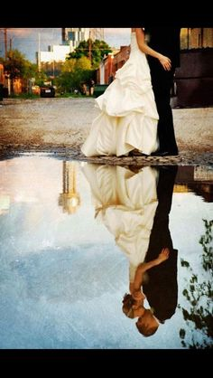 WATER REFLECTIONS - DiDoReflections free music website- DdO:) MOST POPULAR RE-PINS - http://www.pinterest.com/DianaDeeOsborne/dido-reflections/ -  Love's Kiss reflected in the pool. Bride & bridegroom kiss for this professional wedding photography style  portrait beside the still waters. Great photo composition is cropped so that you must look into the still water to see their loving embrace. Blues and black provide a peaceful foreground. Water reflection photo idea pin is via Morgan…