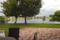 Want to see this home? Call or Text Eric Steinberg, licensed real estate agent - RealtyPRO™ Network LLC Resources for Fort Lauderdale home buyer. Southwest Ranches, Sidewalk, Patio, World, Outdoor Decor, Side Walkway, Walkway, The World, Walkways