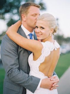 Bringing flirty back. This bride's daring dress is clearly irresistible! (photography by mwfoto.com)
