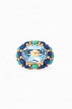 Bague Tesserae  Cobalt profond, turquoise et touches d'éclat entourent une pierre brillante en verre bleu. Cette bague ne passera pas inaperçue à votre doigt. Finition or vieilli. Disponible en P/M et M/G.