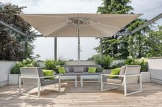 The use of outdoor umbrellas adds that desired luxury resort experience to any home patio. sometimes this is all you need to give your backyard a great Outdoor Seating Areas, Outdoor Dining Set, Outdoor Decor, Outdoor Rooms, Large Outdoor Umbrella, Outdoor Gazebos, Backyard Bar, Patio Umbrellas, Garden Parasols