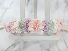 This flower crown is a mix of pastel colour. Only mini hydrangea are used and I think it has created a sweet look.  >>>>>>>>>>>>>>>>>>>>>>>>>>>>>>>>