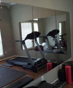 Row of mirrors from Home Depot used in a home or garage gym. Very affordable when done this way; much cheaper than professionally installed mirrors from the local glass company. Great way to replace those $10 mirrors you have lined up on your wall.