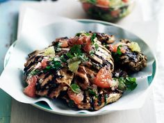 Citrusy Mojito Chicken | The tangy flavors in a mojito inspired these juicy chicken thighs, tossed in fresh grapefruit and lime juice with mint and cilantro and served with a ...
