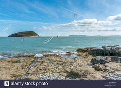 Download this stock image: View over the Menai Straits taken from Penmon Point, Anglesey, North Wales, UK. - E7MNW7 from Alamy's library of millions of high resolution stock photos, illustrations and vectors.